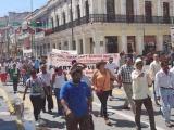 Marchan miembros de la UGOCP para pedir cumplimiento de obras